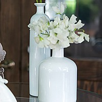 Vintage white glass vase decorations in assorted sizes