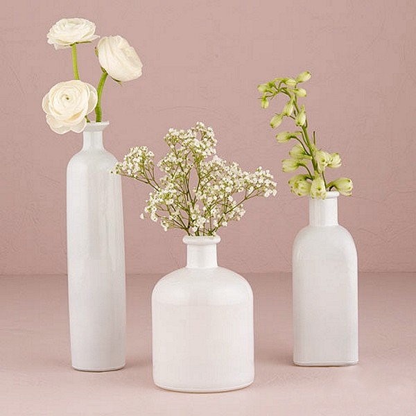 White flower vases in range of sizes and shapes