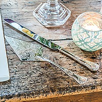 Engraved nickel plated cake server set with intricate filigree designs