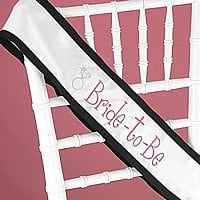 Black grosgrain ribbon sash with ring design and pink embroidery