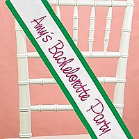 Custom white satin sash embroidered in fuchsia with kelly green trim color