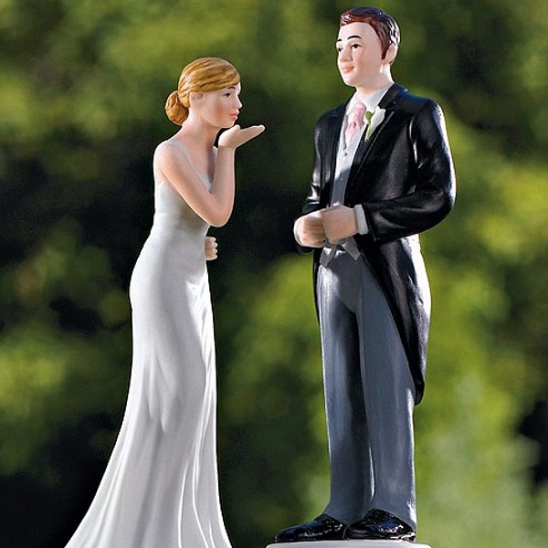 Bride blowing kiss cake topper shown with tradtional morning suit groom cake topper