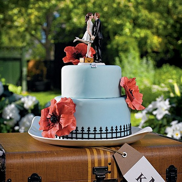 Kissing bride and groom cake topper with suitcase
