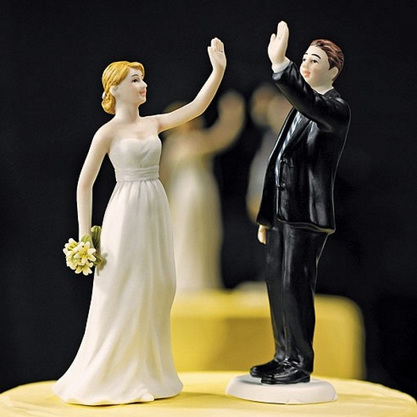 Bride cake topper in high five pose with high five groom