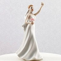 Cheering bride figurine with arm raised in the air
