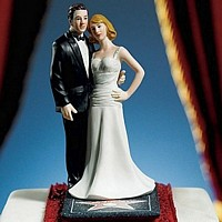 Glamorous red carpet bride and groom cake topper