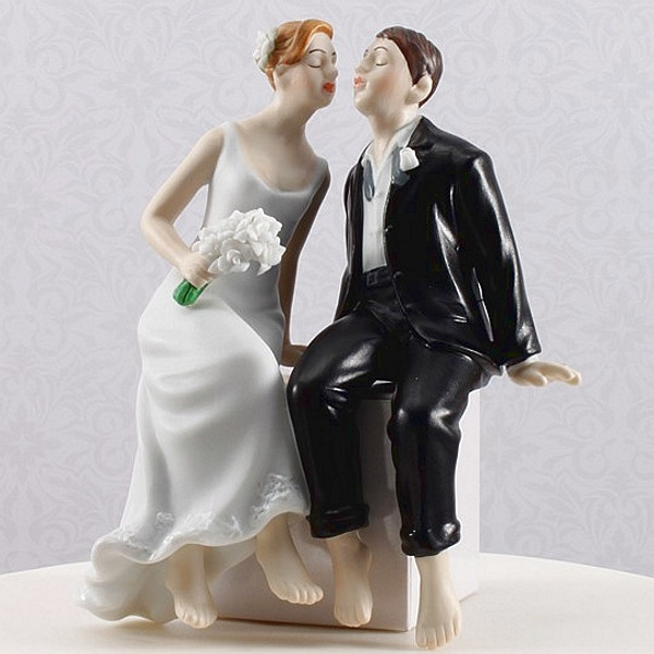 Bride and groom sitting cake topper