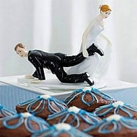 Bride dragging groom to the alter wedding cake topper