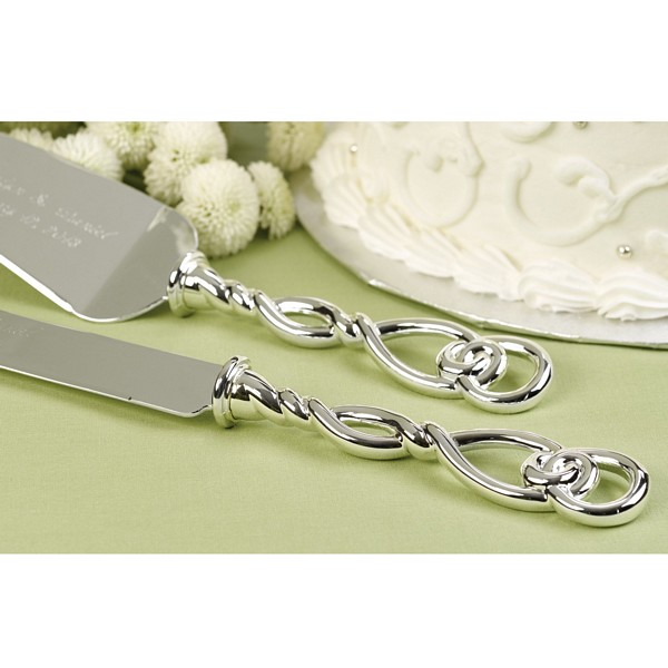 Silver wedding cake knife and server with Celtic love knot design handles