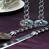 Silver cake server set with traling linked heart handles