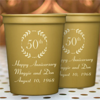 16 Ounce Gold colored plastic anniversary stadium cups personalized with AN111 design and three lines of text in Cheerful lettering style and Ivory imprint color