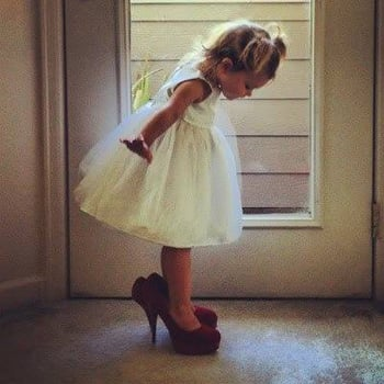 Flower girl in brides shoes via We Heart It