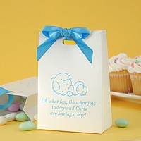 White tote bag favor box printed with Sky Matte imprint color, Caslon Italic letter style, and Baby Design JV10