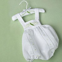 White baby romper with sweet pea design