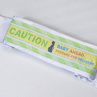 Mom-to-Be sash that reads Caution. Baby ahead. Prepare for Delivery.