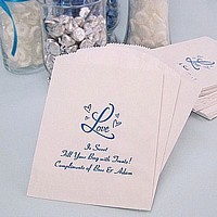 White cake and candy bags personalized with Ocean Matte imprint, WD4 wedding design, and three lines of print in Coronet lettering style