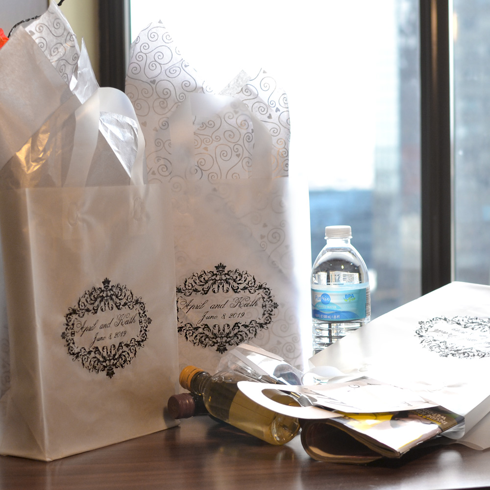 Clear custom printed frosted welcome gift bags with damask design