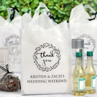 Personalized wedding gift bags in assorted sizes, colors and materials