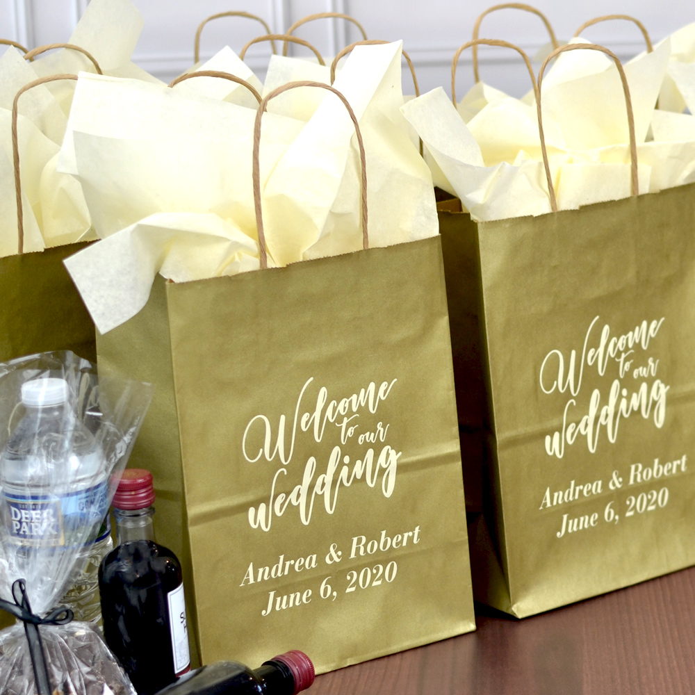 Harvest Gold kraft paper gift bags personalized with WB005 - Welcome Wedding Bold design, bride & groom's name and wedding date with Caslon Italic letter style in Ivory Matte imprint color