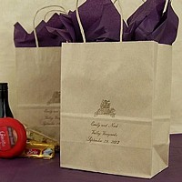 Oatmeal kraft gift bag printed with Gold ink imprint color, HE4 design, and three lines of text in Formal Script lettering style