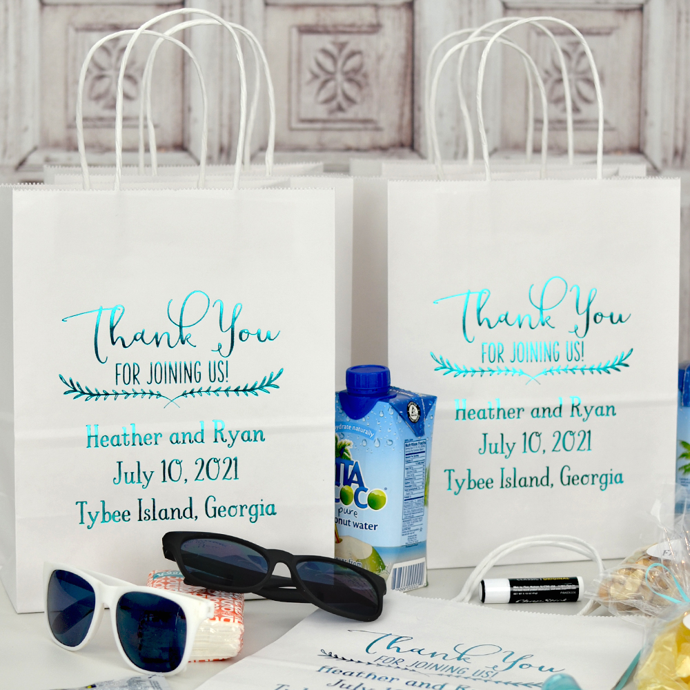 White 8 x 10 Kraft paper wedding welcome bag personalized with WB018 Thank You design and three lines of custom print with Sweetheart letter style in Metallic Teal imprint color