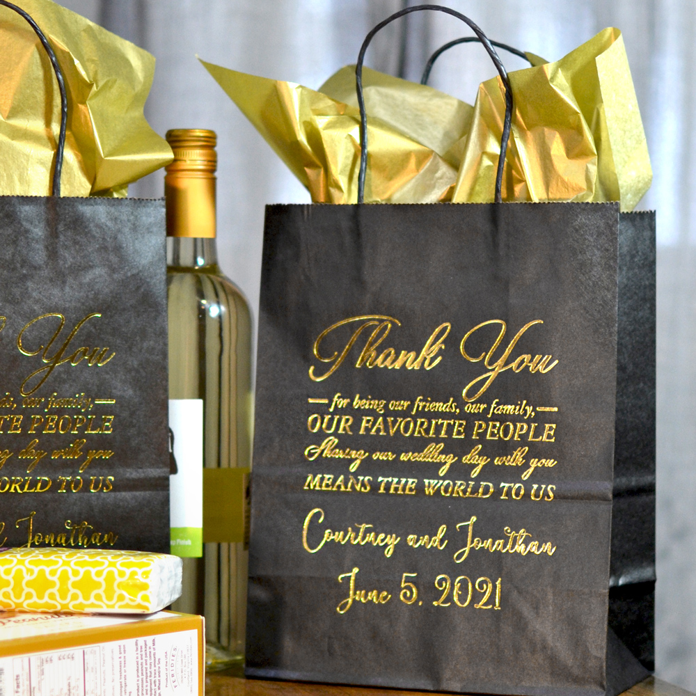 Black 8 x 10 Kraft paper wedding welcome gift bag personalized with WB020 Thank You Favorite People design, bride and groom's name and wedding date with Wispy letter style in metallic gold imprint color