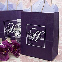 White kraft gift bags custom printed with customer artwork and raspberry ink