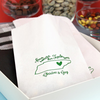 White cake and candy bags printed with Shamrock Matte imprint color and customer supplied artwork
