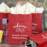 Custom printed 8 x 10 size wedding welcome gift bags in Berry Red with design WB008 Welcome Leaves and two lines of print in Sugar Plum lettering style and Ivory Matte imprint color