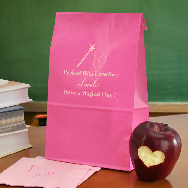 Personalized raspberry lunch bag with fairytale design FT5 printed above 3 lines of text in the caslon letter style with special instructions to print the name in Coronet