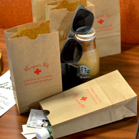 Personalized natural kraft paper hangover kit bags printed with Crimson Matte imprint color, WHK02 design, and Tempo letter style