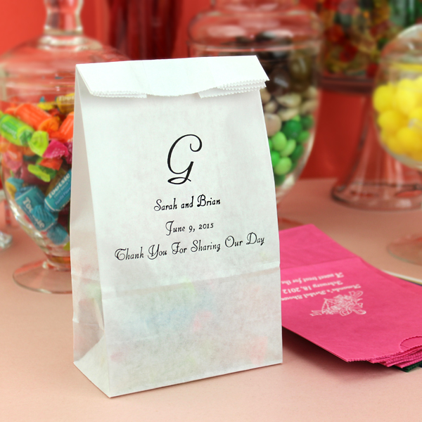 Personalized paper party candy bags available in assorted color options