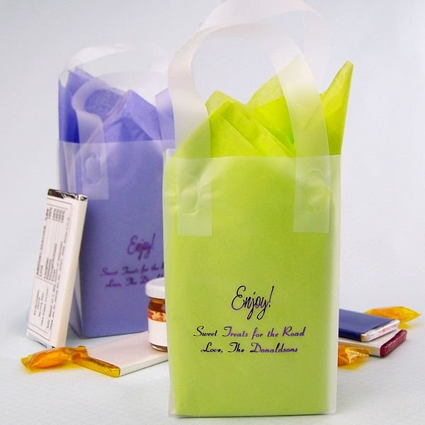 Clear frosted mini gift bags printed with Metallic Purple imprint, HE15 design, and two lines of print in Coronet lettering style and shown with lime green and purple tissue paper