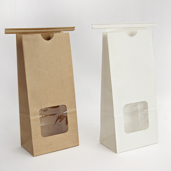 Half pound goody bags with clear window shown in both natural kraft and white colors