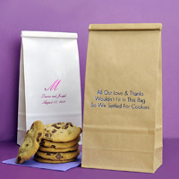Personalized Tin Tie Goodie Bags. Natural Kraft color shown in foreground printed with Metallic Royal Blue imprint color and Tempo lettering style. White bag also shown printed with Fuchsia Satin imrprint color and monogram format Formal Script - FSC