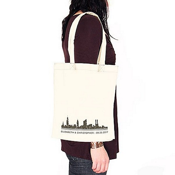 Personalized city skyline canvas tote bag on shoulder
