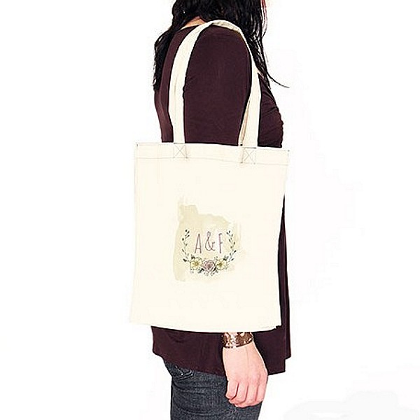 Personalized Natural Charm canvas tote bag on shoulder