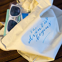 Personalized reusable cotton canvas gift bag filled with comfort items for out of town wedding guests