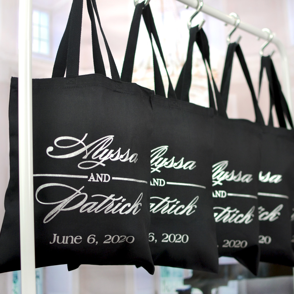 Welcome guests to your wedding hotel rooms with custom printed canvas gift bags filled with goodies and personalized with a design and up to three lines of text in your choice of bag and imprint colors