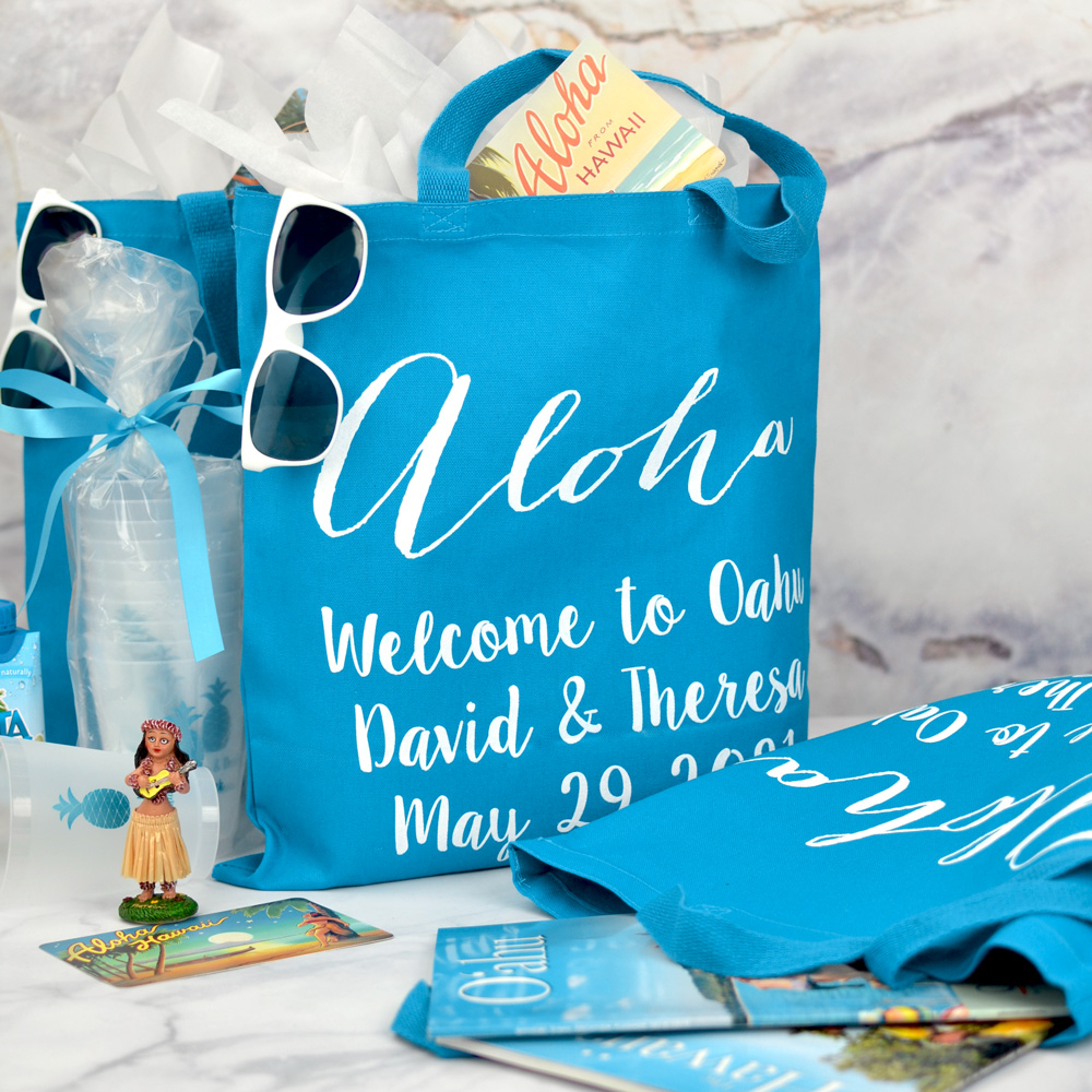 Welcome guests to your destination wedding with custom printed canvas hotel room gift bags personalized with a design and up to three lines of text in your choice of bag and imprint colors