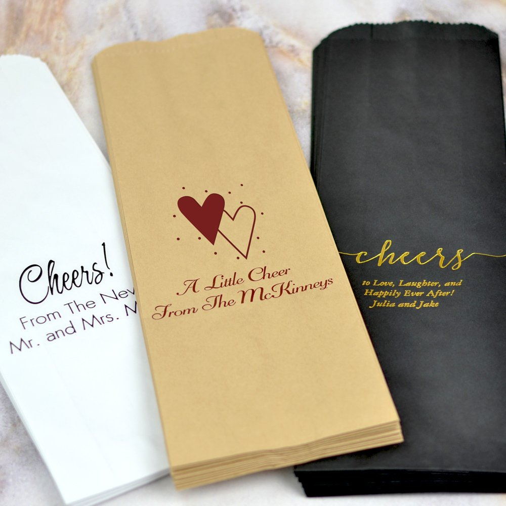 Paper wedding guest gift wine bags in assorted colors and designs