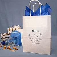 Personalized white kraft bag printed with Snowflakes alternate design, Florentine Cursive lettering style, and Metallic Aqua imprint color