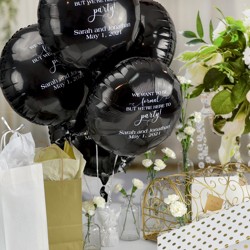 Black Round Mylar balloon personalized with WLP01 - Here To Party design and two lines of text in White imprint using Strong lettering style