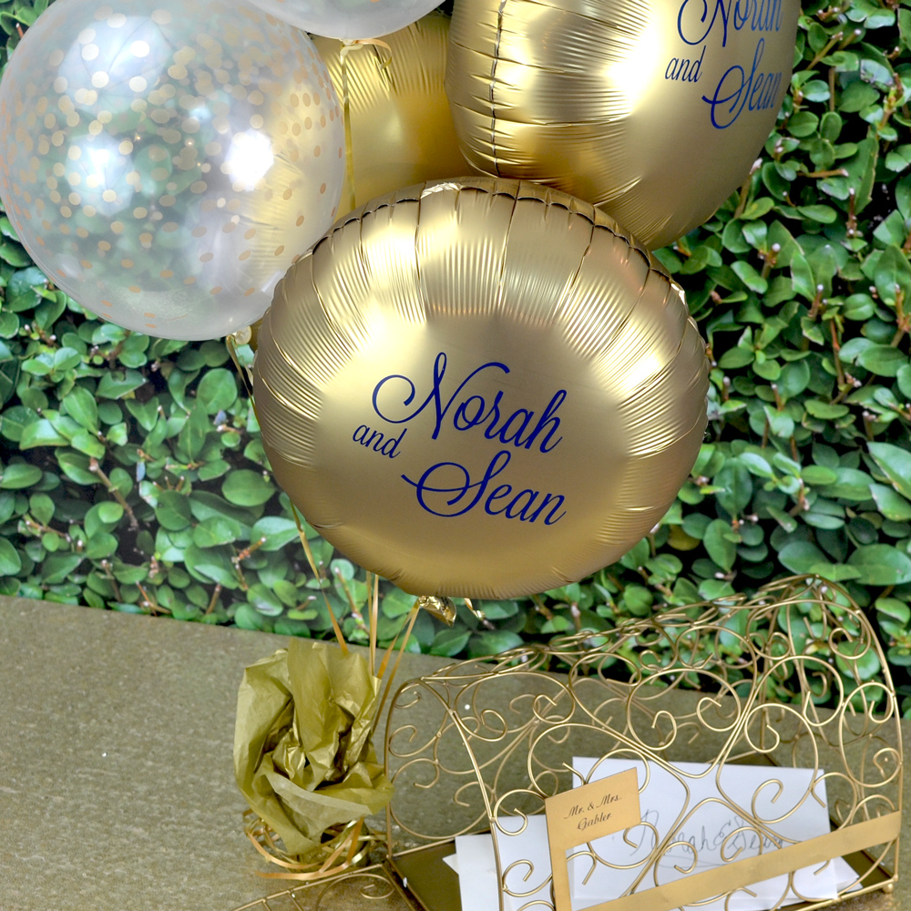 Luxe Gold Sateen round foil balloon personalized with M-54 - Names Monogram in Navy Blue imprint with lettering style Lovable