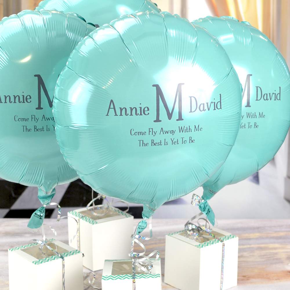 Robins Egg Blue Round Mylar balloon personalized with M-32 - Initial and Names Monogram plus two lines of text in Dark Grey imprint using Sweetheart lettering style