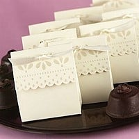 Ivory 3 inch by 3 inch scalloped edge favor boxes with peral embossed design