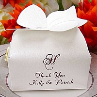 Personalized beargrass bow top favor box printed with Chocolate Matte imprint, 35-S single monogram, and two lines of print in Admiral Script lettering style