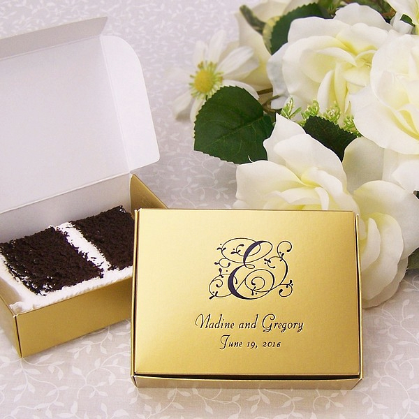 Antique Gold cake box printed with 85-S single monogram, Florentine Cursive letter style, and Ebony Matte imprint color.