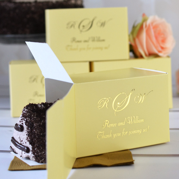 French Vanilla color cake box printed with design VIP-ED1, florentine cursive lettering style, and metallic gold imprint