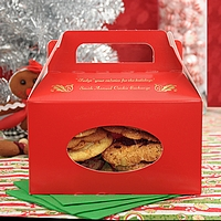 Red Christmas tote boxes printed with Antique Satin imprint color, CMS 27 design, and two lines of text in Mayfair Cursive lettering style